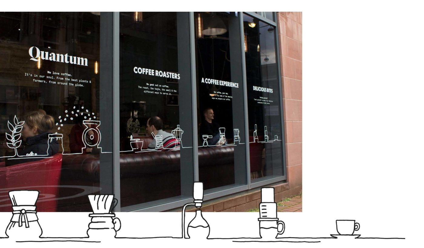 Close up of new Quantum coffee roasters window graphics